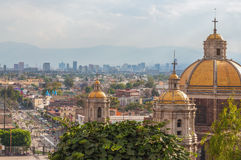 Old Basilica of Guadalupe. With Mexico City skyline behind it Stock Images