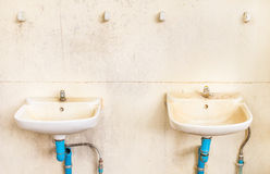Old basin in the bathroom Stock Photo