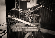 Old basket on antique bicycle Royalty Free Stock Image
