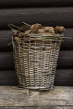 Old basket. Full of cones royalty free stock image