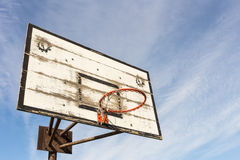 Old basket hoop over sky Royalty Free Stock Photo
