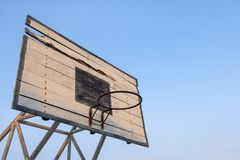 Old basketball backboard, basketball hoops with blue sky background. stock photo