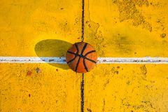 Old basketball in the basketball court. Old basketball background in basketball royalty free stock photography