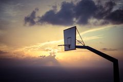 Basketball basket against sunset sky Royalty Free Stock Photos