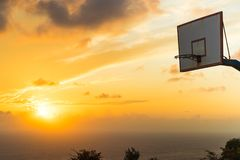 Basketball basket against sunset sky Royalty Free Stock Photo