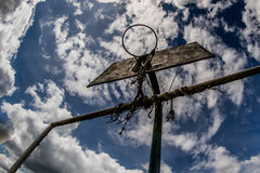 Old basketball court, basket, snatched netting against the sky Stock Images