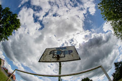 Old basketball court, basket, snatched netting against the sky Royalty Free Stock Photos