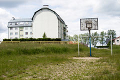 Old basketball court, basket, snatched netting against the sky Stock Photo