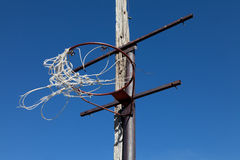 Old basketball goal. And net blowing in the wind royalty free stock photo