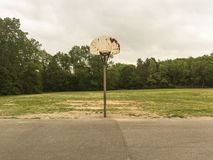 Old Basketball Hoop. Abandoned basketball hoop in park Stock Photo