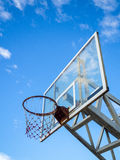 Old basketball hoop against  blue sky. Old basketball hoop with backboard against  blue sky, white cloud Stock Image