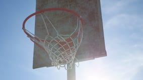 Old basketball hoop against a blue sport street. Old basketball hoop against blue sport street stock video