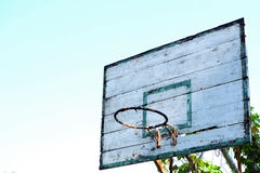 Old basketball hoop with blue sky background Stock Photo