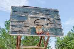 Old Basketball hoop on a blue sky. Stock Photo