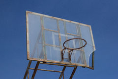 Old basketball hoop. An old basketball hoop consumed by games and matches Royalty Free Stock Image