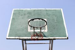 Old Basketball Hoop. An old outdoor basketball hoops in the blue sky Royalty Free Stock Images