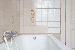 Old bath tub with dirty tiles stock photo