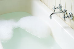 Old bath tube with bubbles Royalty Free Stock Photos