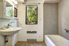 Old bathroom with grey tile wall trim Stock Photos