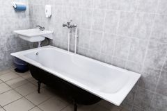 Old bathroom with sink and tiled walls. USSR stock photo