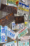 Old and battered car registration plates. Vintage weathered american registration numbers Royalty Free Stock Photos