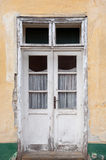 The old battered door on the old house Royalty Free Stock Photo