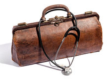 Old battered leather doctors bag and stethoscope royalty free stock photos
