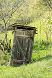 Old battered outhouse Stock Photography
