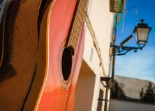 An old battered Spanish guitar hangs outside a bar,,Granada,Andalucia,Spain. royalty free stock image