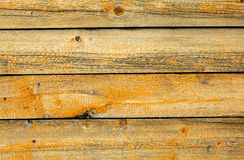 Old battered wall are covered with boards Royalty Free Stock Images