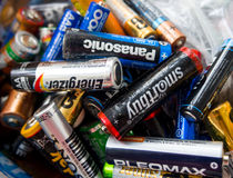 The old batteries are collected in a container for disposal Stock Image