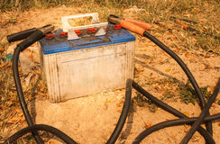 Old battery and the jumper cables Stock Images