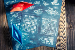 Old battleship paper game ready to play Royalty Free Stock Photo