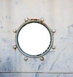 Old battleship round window Royalty Free Stock Images