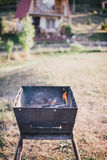 Old BBQ with fire on the country background Stock Image