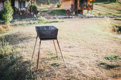 Old BBQ with fire on the country background Stock Photography
