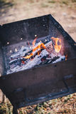 Old BBQ with fire on the country background Royalty Free Stock Photography