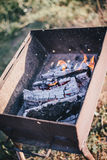 Old BBQ with fire on the country background Stock Photos