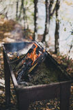 Old BBQ with fire on the forest background Stock Photos