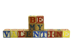 Old Be My Valentine. Vintage style colored wood alphabet blocks spelling Be My Valentine Royalty Free Stock Images