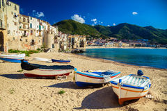 Old beach in Cefalu with fishing boats Stock Images