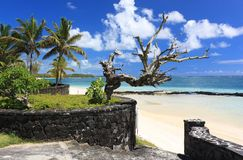 Old beach entrance in Mauritius island. Landscape view of tropical beach with blue cloudy sky in background Royalty Free Stock Photos