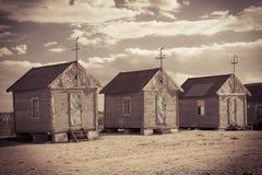 Old beach huts, retro sepia toned image Stock Photography