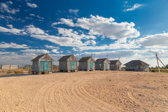 Old beach huts on the sand Stock Images