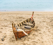 Old beached fishing Boat - Asian Style. Dramatic view of an old beached fishing boat in Ko Lanta, Thailand Royalty Free Stock Photos