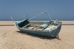 Old beached fishing Boat Stock Photo