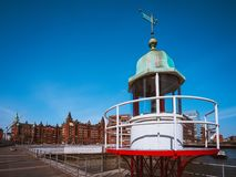 Old beacon or small lighthouse in Hamburg Hafencity.  Stock Photography