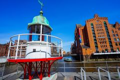 Old beacon or small lighthouse near river channel in Hamburg Hafencity.  Stock Photography