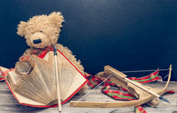 Old bear and bow with arrow. Old bear with vintage old book and bow with arrow stock images