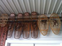 Old Bear Paw Snowshoes Stock Photography